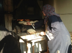 When baked, the bread is collected from the oven...