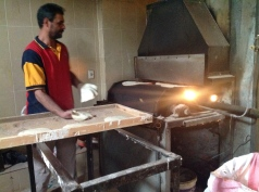 """In the village, """"baladi bread"""" (flat wholemeal rounds) is ready for baking."""